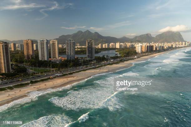 aerial view from helicopter flight to city buildings, lagoon and beach - バーラ地区 ストックフォトと画像