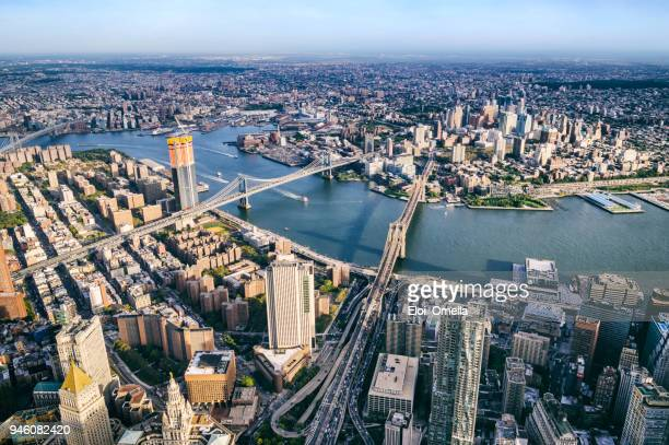 aerial view from helicopter of bmw bridges. brooklyn, manhattan and williamsburg bridges. new york - lower manhattan stock photos and pictures