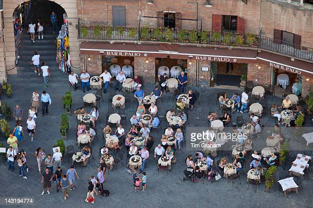 Aerial view from Il Torre clock tower of diners at Bar Il Palio in Piazza del Campo Siena Italy