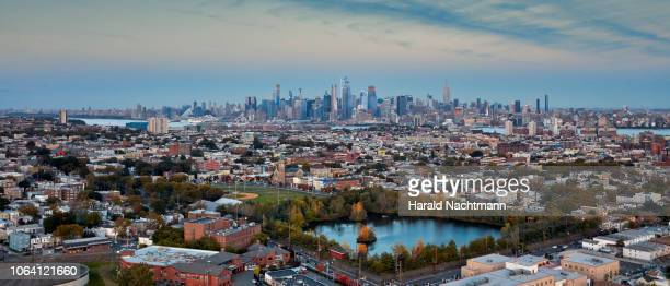 aerial view from jersey city to the manhattan skyline, new york city, new york, united states - new jersey stock pictures, royalty-free photos & images