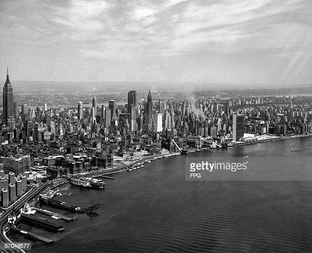 Aerial view from the East River looking west of the East Midtown Manhattan skyline New York New York 1950s or 1960s Prominant structures include the...