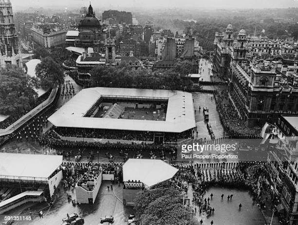 Aerial view from the Elizabeth Tower of the Coronation procession of Queen Elizabeth II with the monarch traveling in a horse drawn royal coach as...