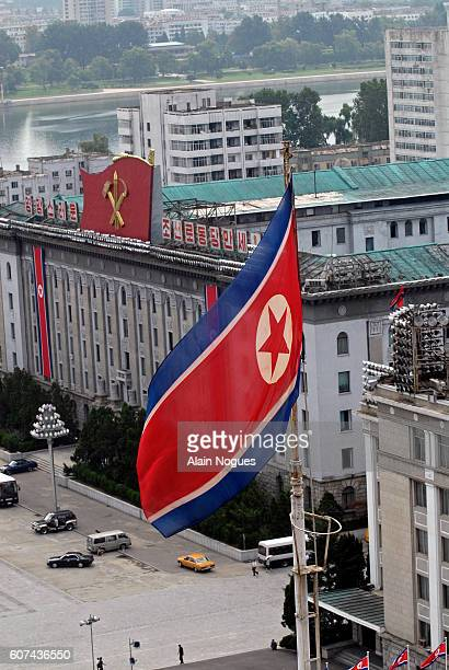 Aerial view from the Grand People's Study House overlooking the North Korean flag and Workers' Party insignia composed of a hammer paint brush and...
