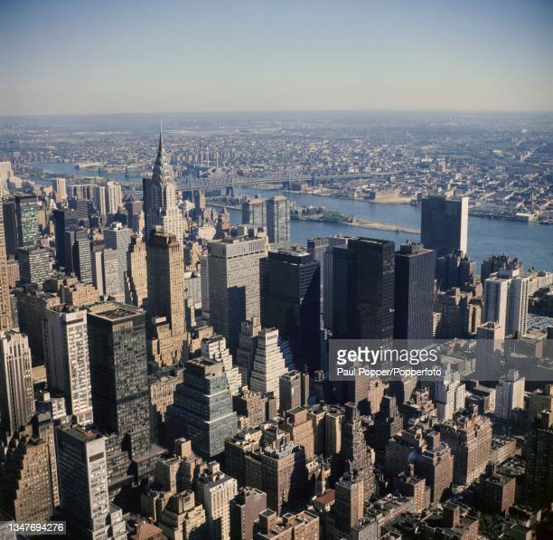 Aerial view from the top of the Empire State Building looking east towards the Chrysler Building, skyscrapers in Manhattan, Roosevelt Island in the...