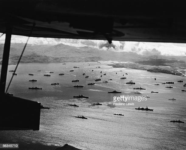 Aerial view from underneath an aircraft of a large American naval fleet at Adak Harbor in the Aleutian Islands Alaska 1943