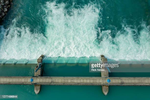 aerial view from water barrage - hydroelectric power stock pictures, royalty-free photos & images