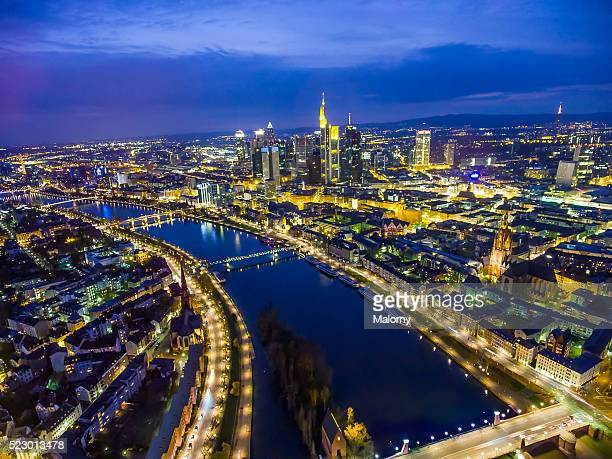 Aerial View. Germany, Frankfurt, River Main, skyline of financial district in background at night.