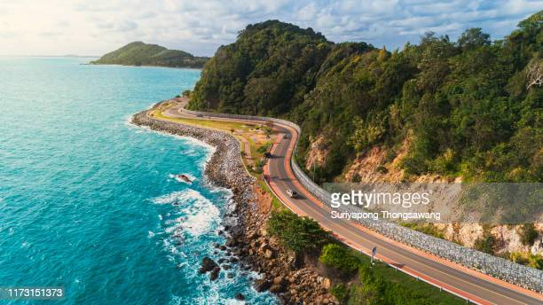 aerial view highway road along the sea. - coastline stock pictures, royalty-free photos & images