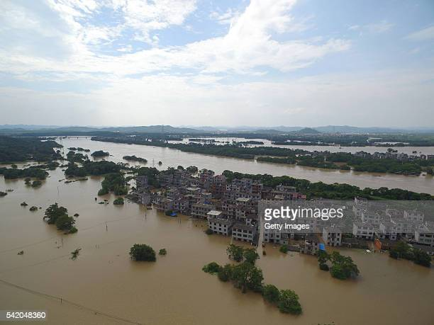 Aerial view image shows flood swamping resident buildings in Nianyushan Town of Changjiang District on June 21 2016 in Jingdezhen Jiangxi Province of...