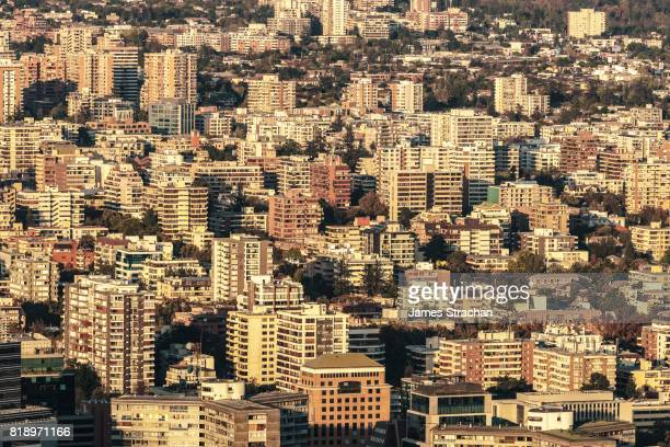 Aerial view in setting sun from Cerro San Cristobal of apartment buildings, Santiago, Chile
