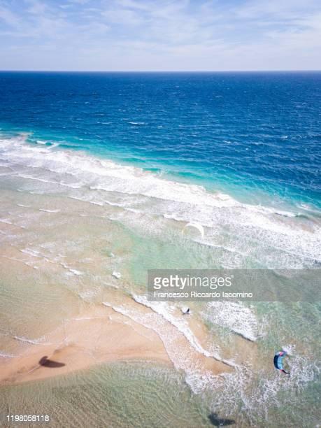 aerial view kiteboarding at sotavento beach, fuerteventura, canary islands - francesco riccardo iacomino spain foto e immagini stock