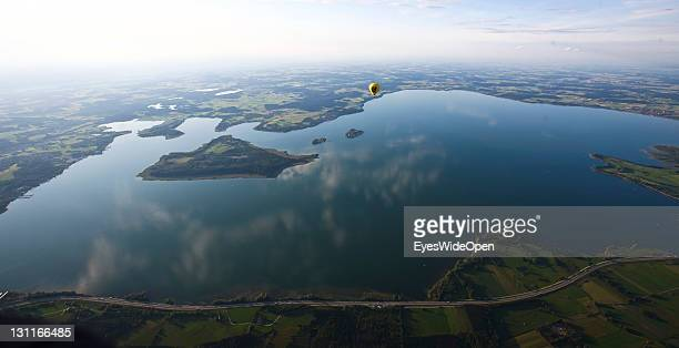 Aerial view landscape and panoramic view from a balloon on the lake of Chiemsee island Herreninsel and the autoroute A8 on August 11 2011 in Aschau a...