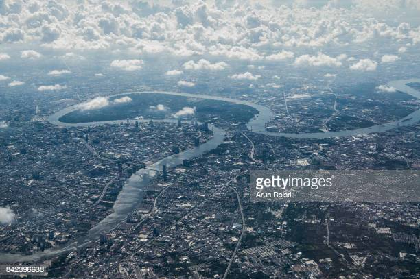 aerial view landscape of bangkok city in thailand with clouds and river. - haut photos et images de collection