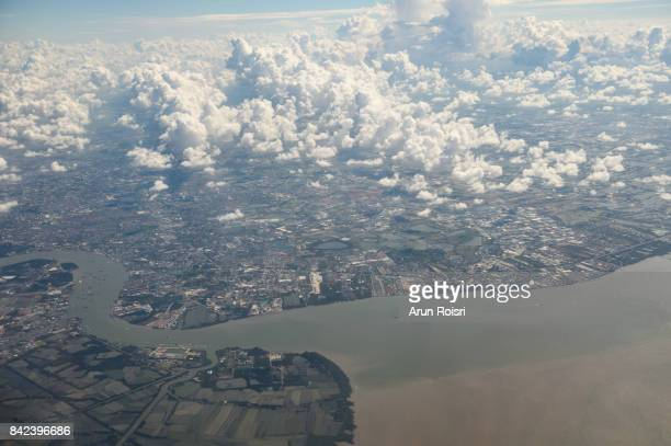 Aerial view landscape of Bangkok city in Thailand with clouds and river.