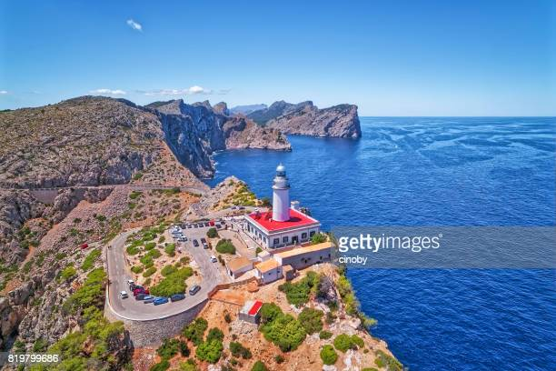 aerial view lighthouse - cap de formentor (seaside) and the famous cliffs of balearic islands majorca / spain - majorca stock pictures, royalty-free photos & images