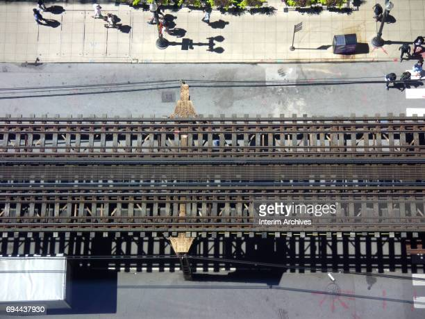 Aerial view looking down of elevated train tracks on Wabash Avenue a part of the Chicago Loop Chicago Illinois September 2 2016