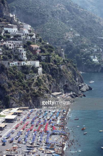 Aerial view looking down on sunbathers and parasols on the beach at Positano Italy 1979