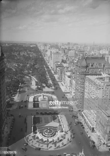 Aerial view looking north at the corner of Fifth Avenue and 59th Street with the Plaza Hotel and Central Park visible on the left and showing...
