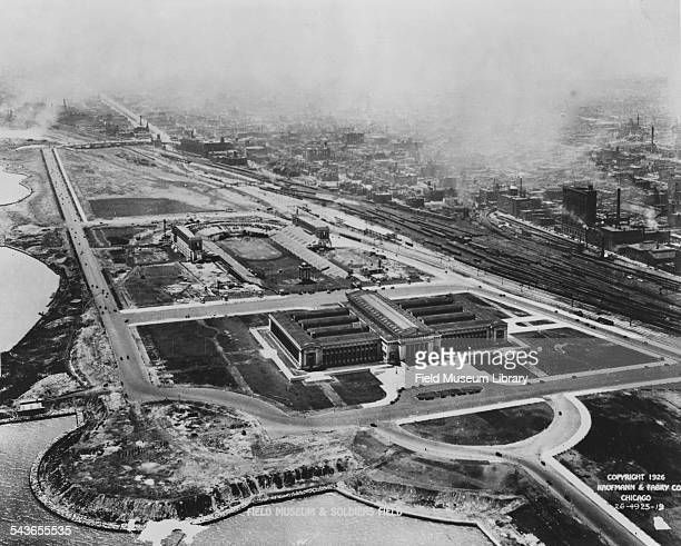 Aerial view looking south showing the Field Museum in the foreground with Soldier Field nearly complete behind, Chicago, Illinois, 1926. The Shedd...