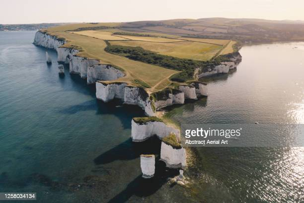 aerial view looking towards old harry rocks at sunset, dorset, england, united kingdom - jurassic coast stock pictures, royalty-free photos & images