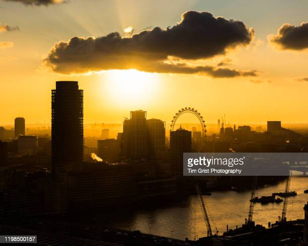 aerial view looking west over the london skyline at sunset - tim grist stock pictures, royalty-free photos & images