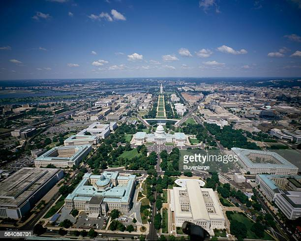 Aerial view looking west showing Library of Congress Thomas Jefferson Building and James Madison Building the Supreme Court and the US Capitol...