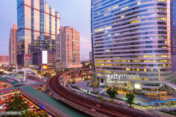 aerial view modern office buildings in bangkok city downtown with sunset time - シーロム ストックフォトと画像