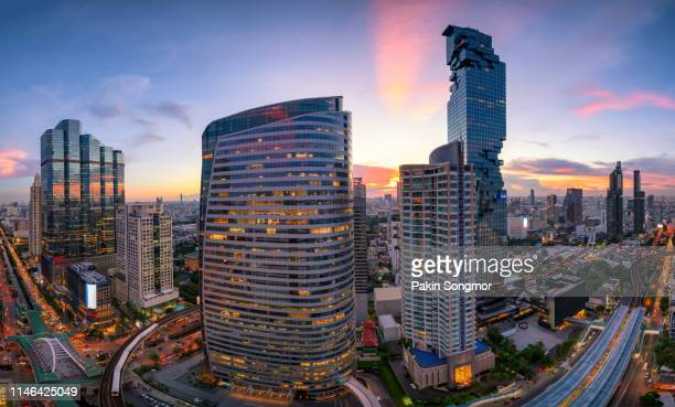 aerial view modern office buildings in bangkok city downtown with sunset time - bangkok fotografías e imágenes de stock