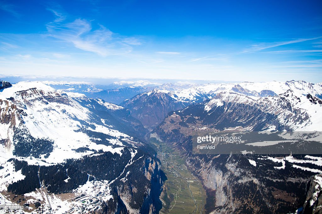 Aerial view mountain Swiss Alps tops covered in snow : Stock Photo