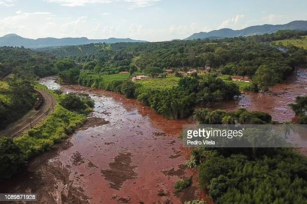 Aerial view mudslides area a day after the collapse of a dam at an ironore mine belonging to Brazil's giant mining company Vale on January 26 2019 in...