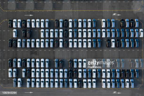aerial view new cars lined up in the port for import and export. - car dealership stock pictures, royalty-free photos & images