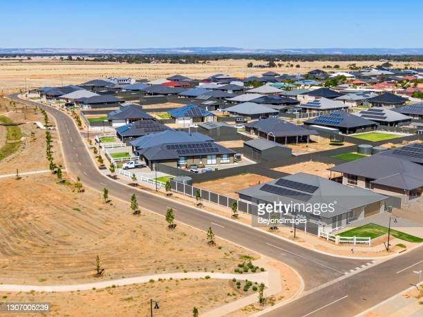 aerial view, new rural housing development being built on former quality food-producing farmland. - housing development stock pictures, royalty-free photos & images