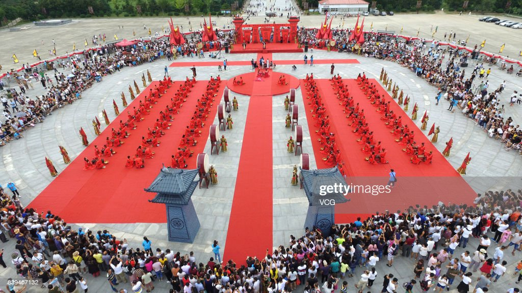Aerial View Of 100 Newlyweds Wearing Han Dynasty Style Outfits Attend A Group Wedding On August