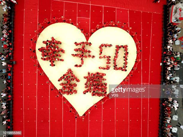 Aerial view of 101 senior couples celebrating their 50th anniversaries one day before the Qixi Festival the Chinese Valentine's Day at Laojun...