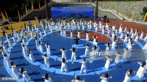 Aerial view of 200 women performing Kong Fu yoga at Laojun Mountain on July 7, 2017 in Luoyang, Henan Province of China. Miya Muqi, an actress in...