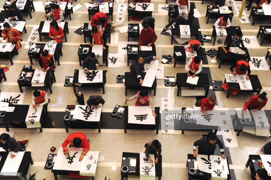Teenagers participating in chinese calligraphy competition stock