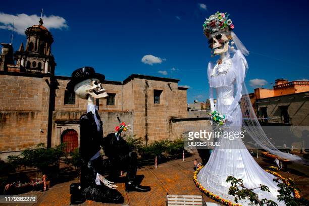 Aerial view of a 20meterhigh Catrina figure the biggest in the world dressed up as a bride and the Catrin her groom in the main square of Zapotlanejo...