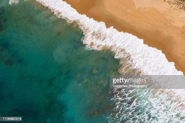 aerial view of a beach in caloundra, sunshine coast with turquoise coloured water, sea foam and golden sand - sunshine coast australia stock pictures, royalty-free photos & images