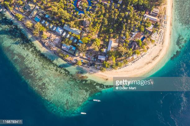 aerial view of a beach in the stunning gili air island off the coast of lombok in indonesia - lombok fotografías e imágenes de stock