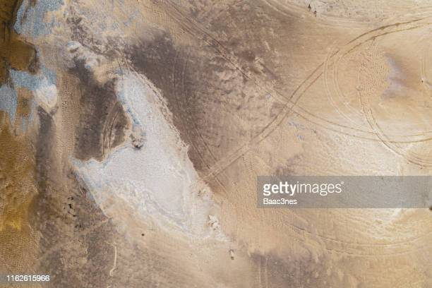 aerial view of a beach with tire tracks in the sand - land stock pictures, royalty-free photos & images
