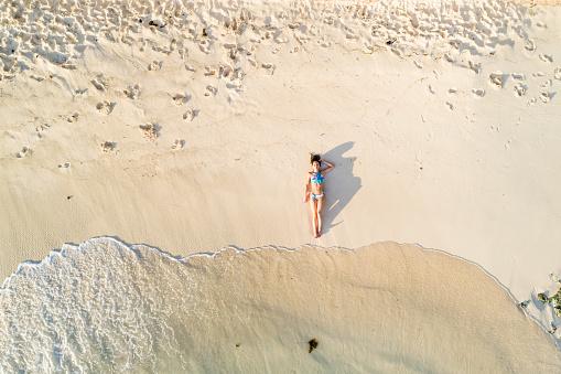 Aerial view of a beautiful woman sunbathing - gettyimageskorea