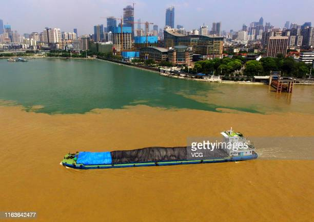 Aerial view of a boat steering through the Yangtze River and the Han River in front of Hankou Longwang Temple on July 15 2019 in Wuhan Hubei Province...