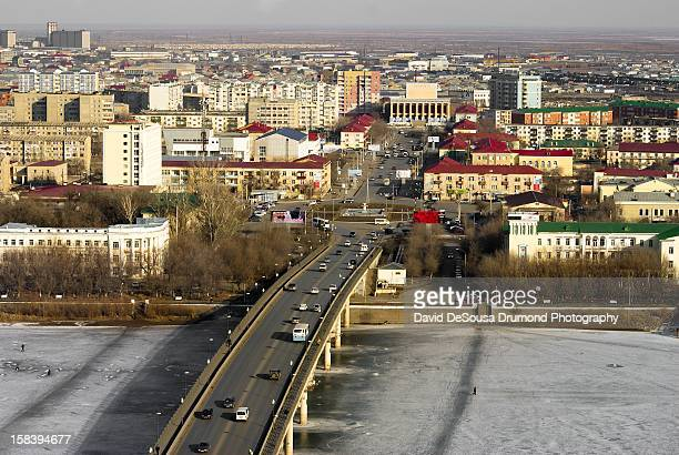 Aerial view of a bridge over the frozen Ural