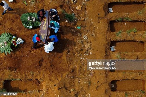 Aerial view of a burial at the Vila Formosa cemetery during the COVID-19 coronavirus pandemic, in Sao Paulo, Brazil, on March 23, 2021. - Brazil's...