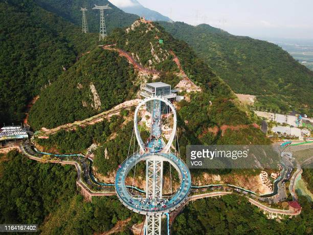 Aerial view of a circular glass bridge at the Huangtengxia tourist attraction on July 23 2019 in Qingyuan Guangdong Province of China Dozens of...