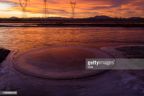 Aerial view of a circular ice floe on the Taoer River on December 3, 2020 in Hohhot, Inner Mongolia Autonomous Region of China.