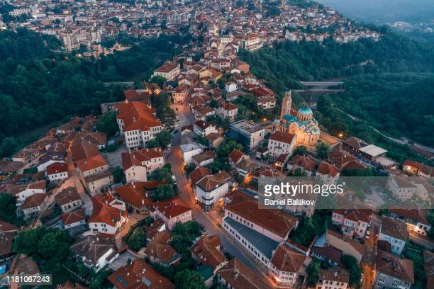 aerial view of a city at dusk. travel destinationse. - bulgaria stock pictures, royalty-free photos & images