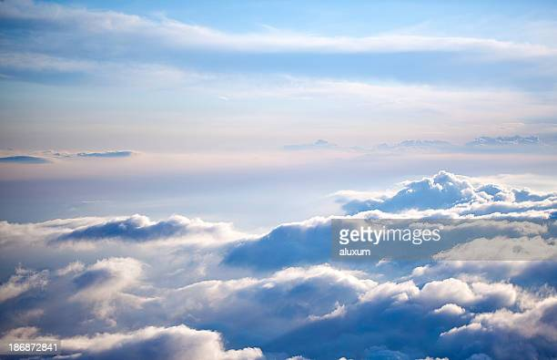 aerial view of a cloudscape on a clear day - elysium stock photos and pictures