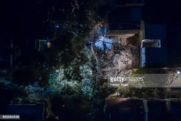 Aerial view of a collapsed school at Condesa neighborhood after the magnitude 71 earthquake jolted central Mexico damaging buildings knocking out...