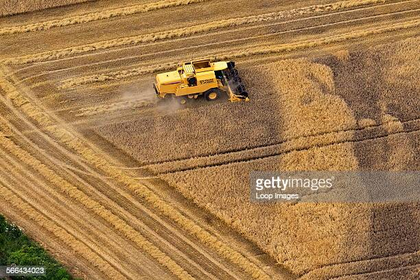 Aerial view of a combine harvester at work